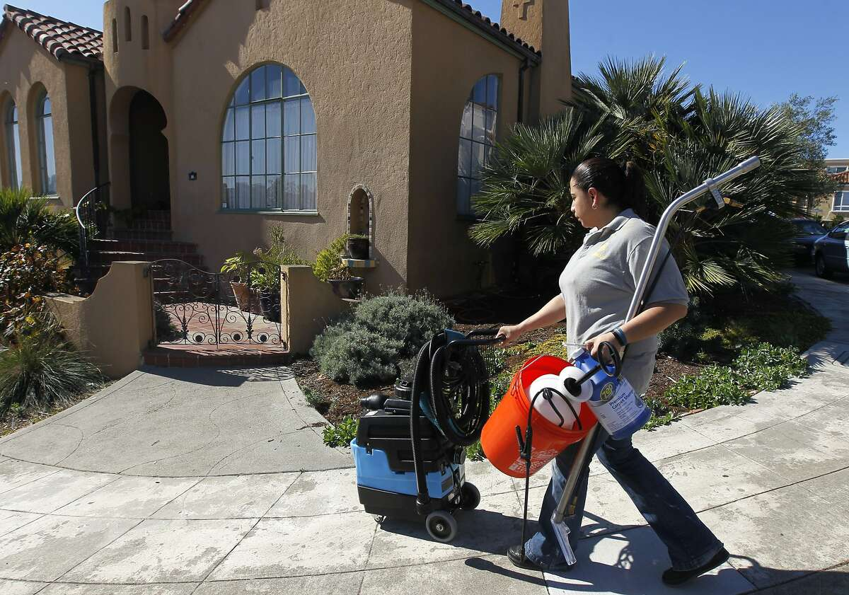 Rosa Sanchez, a carpet and upholstery cleaner for Homejoy, arrives with steam cleaning equipment at Rie Yamazaki-Bach's home in San Francisco, Calif. on Tuesday, Oct. 28, 2014. Many homeowners are turning to Homejoy to connect with maintenance services such as carpet cleaning, plumbing and painting.