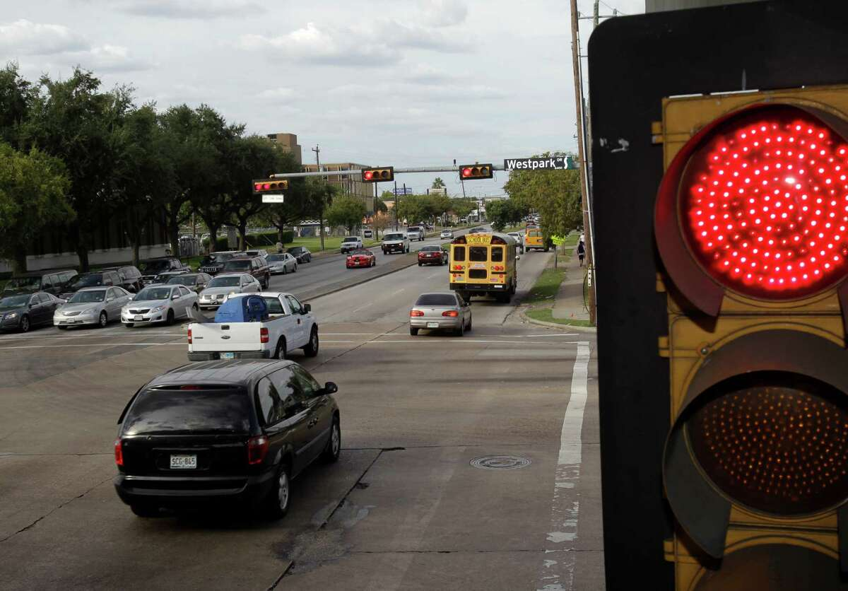 Vehicles are shown running a red light on Hillcroft at the intersection of Westpark on Tuesday, Oct. 28.