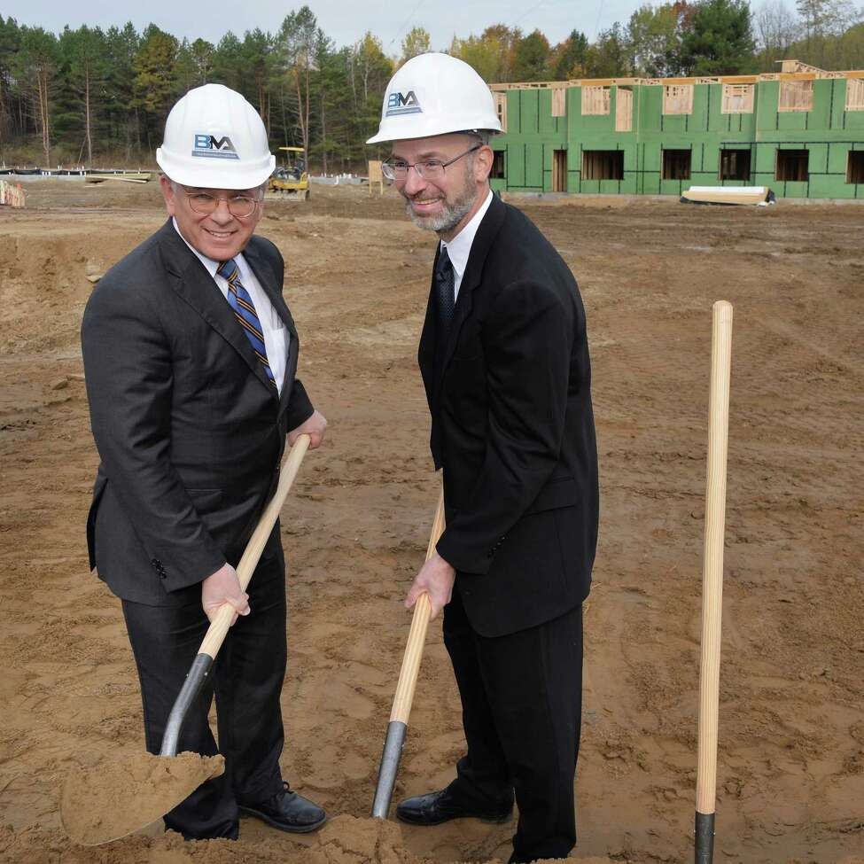 Congressman Paul Tonko, left, and developer David Bruns during ground breaking ceremonies for his NetZero Village project Tuesday Oct. 28, 2014, in Rotterdam,NY. (John Carl D'Annibale / Times Union)