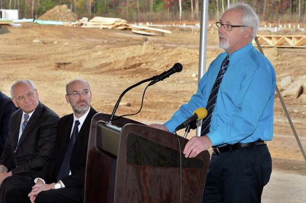 NYSERDA's James Quirk, right, speaks as Congressman Paul Tonko, left, and developer David Bruns listen during ground breaking ceremonies for his NetZero Village project Tuesday Oct. 28, 2014, in Rotterdam,NY.  (John Carl D'Annibale / Times Union) Photo: John Carl D'Annibale / 00029234A