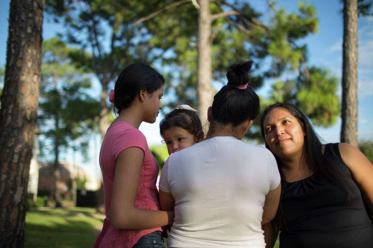 Claudia Palma, right, left Honduras after enduring domestic violence and was separated from her daughters, pictured with a granddaughter, for 14 years.