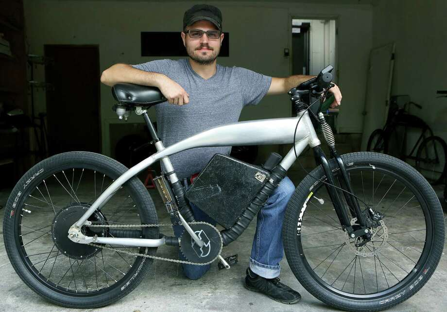 "Bryan Martin with his prototype ""Bronco Model"" electric bicycle in his garage at home.  Monday Oct. 27, 2014. Photo: BOB OWEN, San Antonio Express-News / © 2014 San Antonio Express-News"