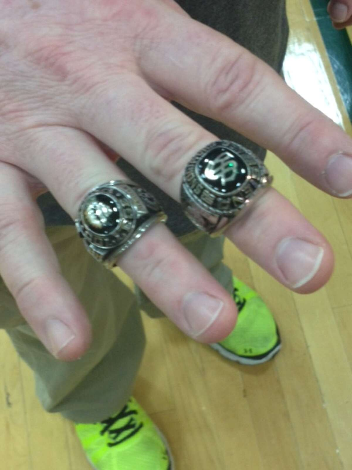 Siena trainer Greg Dashnaw shows off his two recovered rings Tuesday -- from Siena's 1988 NIT appearance (left) and 1989 NCAA Tournament appearance. (Mark Singelais / Times Union)