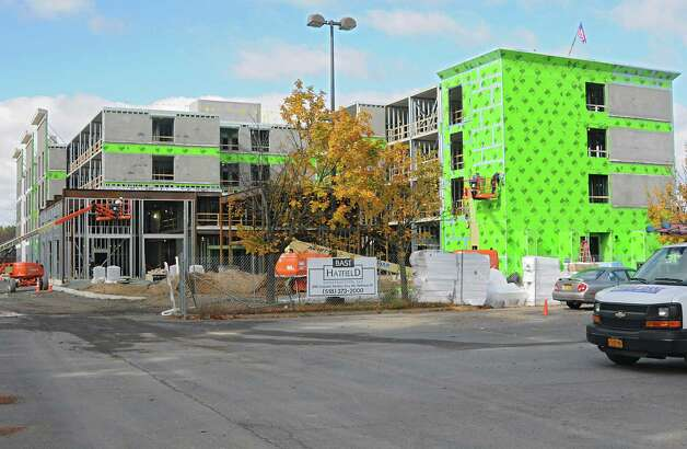 Construction continues on the new hotel Homewood Suites by Hilton on the south side of Clifton Park Center on Monday, Oct. 27, 2014 in Clifton Park, N.Y. (Lori Van Buren / Times Union) Photo: Lori Van Buren / 00029214A