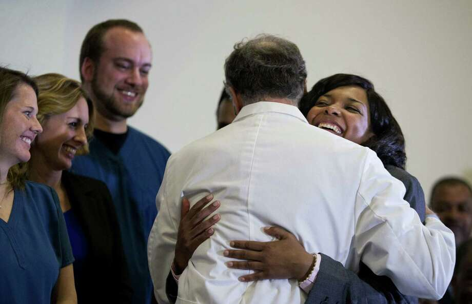 Amber Vinson hugs Emory University Hospital epidemiologist Dr. Bruce Ribner after being discharged from the hospital. Photo: David Goldman / Associated Press / AP