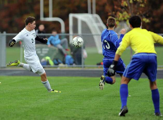 Schalmont's Chris Hamilton, left, takes a shot on goal during their boy's high school soccer game against Hoosick Falls on Friday Oct. 24, 2014 in Rotterdam, N.Y.  (Michael P. Farrell/Times Union) Photo: Michael P. Farrell / 00029192A