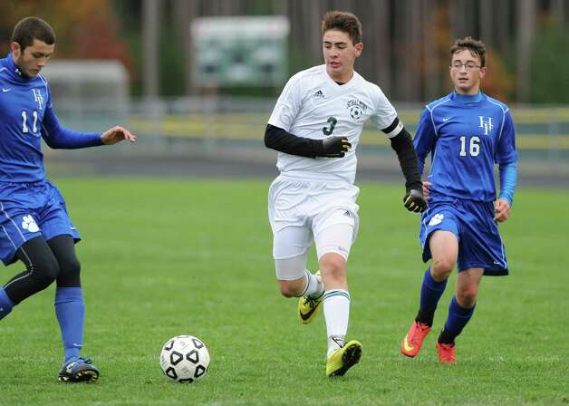 Schalmont's Chris Hamilton, center, during their boy's high school soccer game against Hoosick Falls on Friday Oct. 24, 2014 in Rotterdam, N.Y.  (Michael P. Farrell/Times Union) Photo: Michael P. Farrell / 00029192A