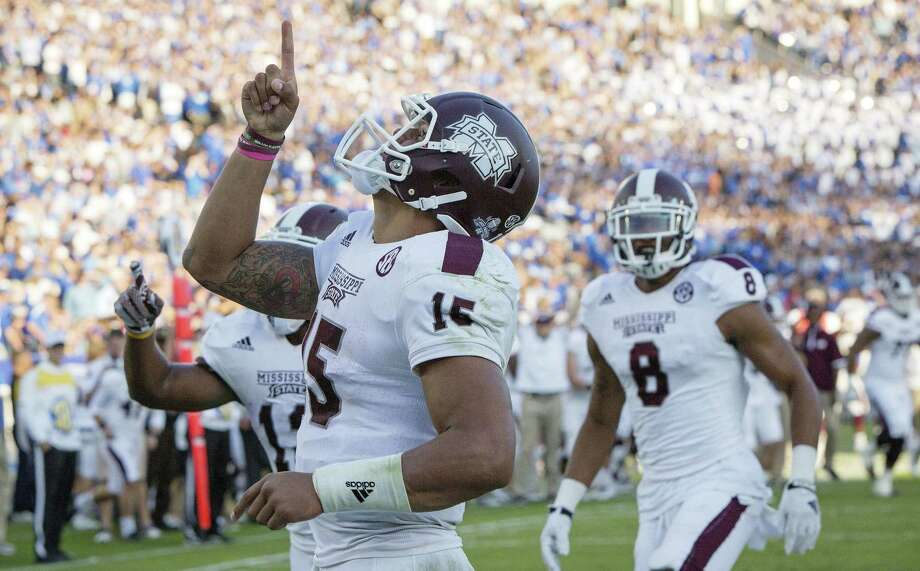 Dak Prescott and Mississippi State top the College Football Playoff standings, which at season's end will determine the four tournament participants. Photo: David Stephenson / Associated Press / FR171246 AP