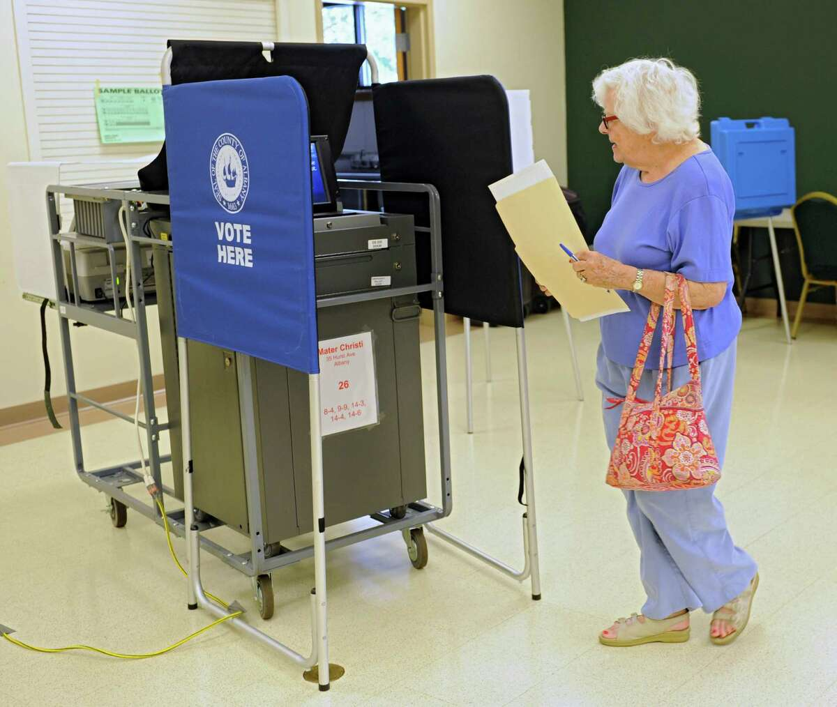 Margaret Sanders of Albany votes in Tuesday's primary at the Mater Christi Parish Center polling place, Sept. 9, 2014 in Albany, N.Y. (Lori Van Buren / Times Union)