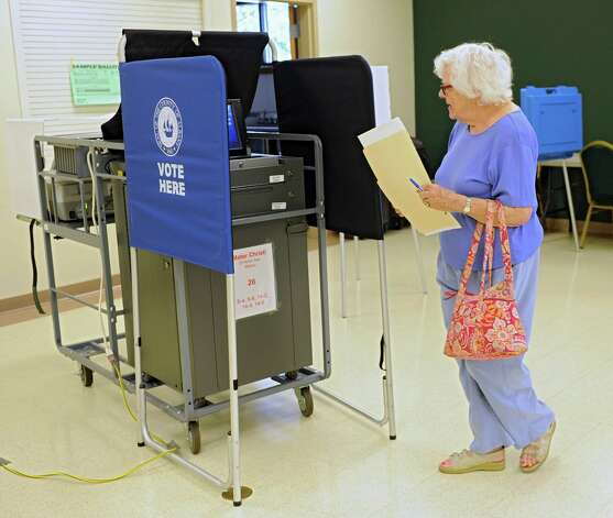 Margaret Sanders of Albany votes in Tuesday's primary at the Mater Christi Parish Center polling place, Sept. 9, 2014 in Albany, N.Y. (Lori Van Buren / Times Union) Photo: Lori Van Buren / 00028466A