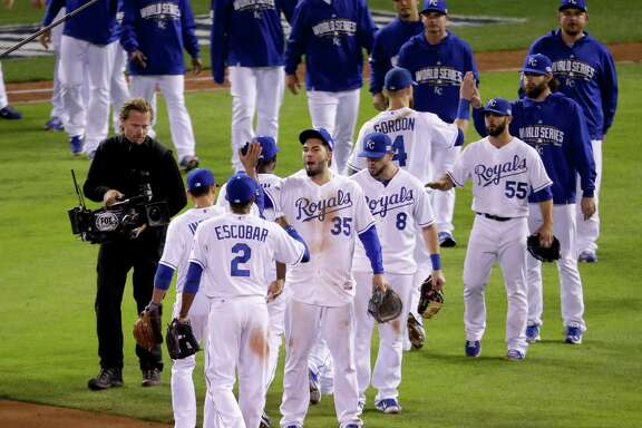 Members of the Kansas City Royals celebrate their 10-0 win against the San Francisco Giants in Game 6 of baseball's World Series Tuesday, Oct. 28, 2014, in Kansas City, Mo. (AP Photo/Charlie Riedel)