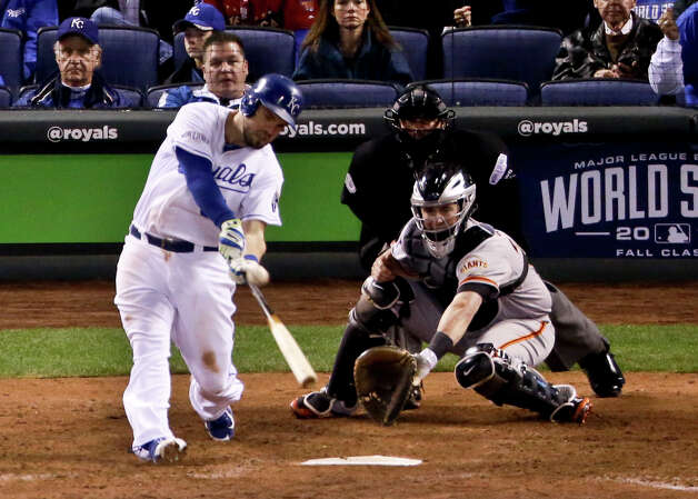Kansas City Royals' Mike Moustakas watches his home run against the San Francisco Giants during the seventh inning of Game 6 of baseball's World Series Tuesday, Oct. 28, 2014, in Kansas City, Mo. (AP Photo/Charlie Riedel)  ORG XMIT: WS539 Photo: Charlie Riedel / AP