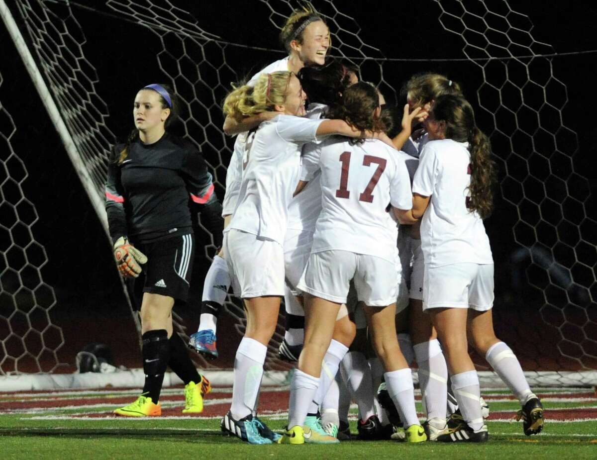Burnt Hills-Ballston Lake celebrates their game winning goal as they defeated Queensbury 2-1 the Class A girls' soccer semifinals on Tuesday Oct. 28, 2014 in Stillwater, N.Y. (Michael P. Farrell/Times Union)