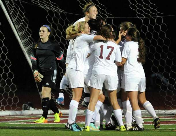 Burnt Hills-Ballston Lake celebrates their game winning goal as they defeated Queensbury 2-1 the Class A girls' soccer semifinals on Tuesday Oct. 28, 2014 in Stillwater, N.Y. (Michael P. Farrell/Times Union) Photo: Michael P. Farrell / 00029235A