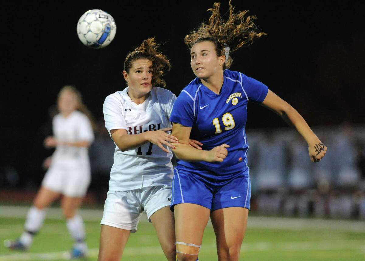 Burnt Hills-Ballston Lake's Lindsey Jameson and Queensbury's Claire Hubbs battle for the ball during their Class A girls' soccer semifinals on Tuesday Oct. 28, 2014 in Stillwater, N.Y. (Michael P. Farrell/Times Union)