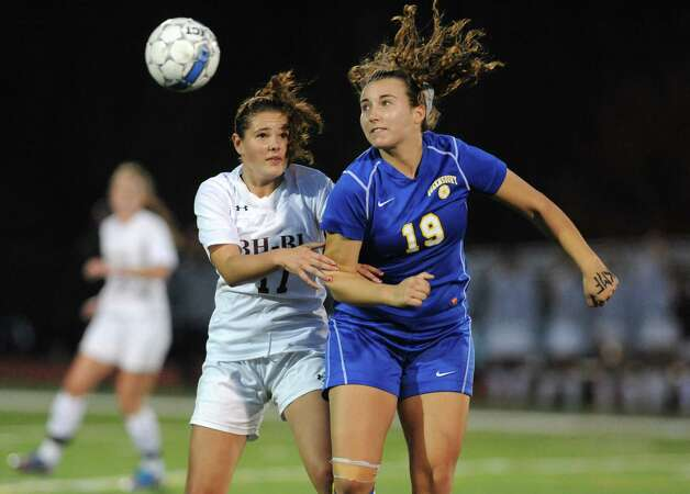 Burnt Hills-Ballston Lake's Lindsey Jameson and Queensbury's Claire Hubbs battle for the ball during their Class A girls' soccer semifinals on Tuesday Oct. 28, 2014 in Stillwater, N.Y. (Michael P. Farrell/Times Union) Photo: Michael P. Farrell / 00029235A