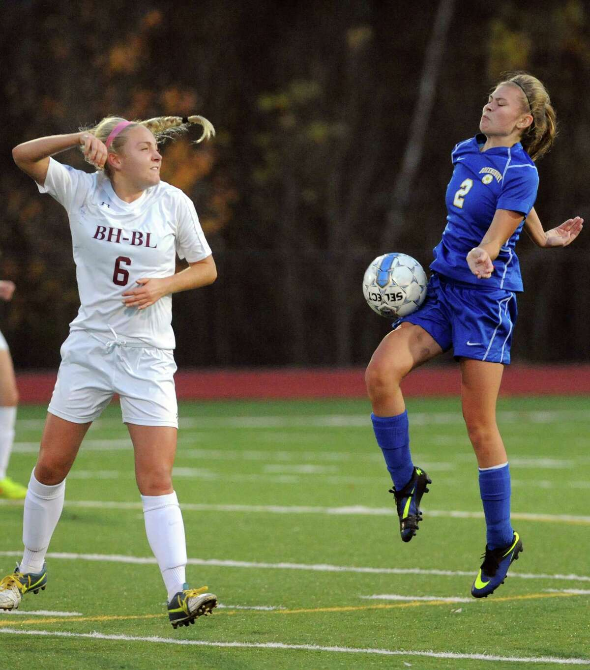 Burnt Hills-Ballston Lake's Casey Doherty and Queensbury's Sarah Logan battle for the ball during their Class A girls' soccer semifinals on Tuesday Oct. 28, 2014 in Stillwater, N.Y. (Michael P. Farrell/Times Union)