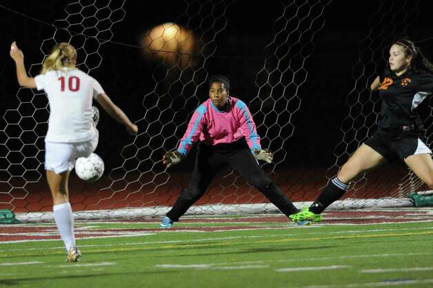 Scotia-Glenville's Kelsey Martin scores her second goal of the night during their Class A girls' soccer semifinals against Mohonasen on Tuesday Oct. 28, 2014 in Stillwater, N.Y. (Michael P. Farrell/Times Union) Photo: Michael P. Farrell / 00029235A