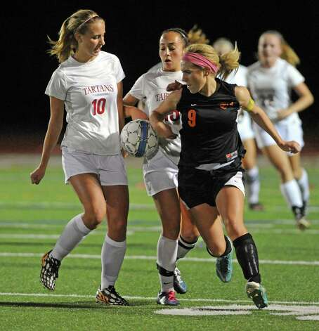 Scotia-Glenville players Kelsey Martin and Dom Puglisi battle Mohonasen's Maddie Egan during their Class A girls' soccer semifinals on Tuesday Oct. 28, 2014 in Stillwater, N.Y. (Michael P. Farrell/Times Union) Photo: Michael P. Farrell / 00029235A