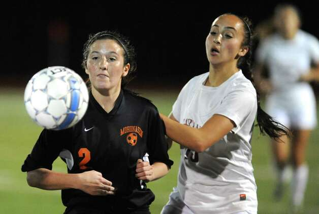 Scotia-Glenville's Dom Puglisi and Mohonasen's Taylor Wood battle for the ball during their Class A girls' soccer semifinals on Tuesday Oct. 28, 2014 in Stillwater, N.Y. (Michael P. Farrell/Times Union) Photo: Michael P. Farrell / 00029235A
