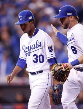 Yordano Ventura gets an attaboy from third baseman Mike Moustakas on the way back to the dugout after the top of the sixth inning. The 23-year-old rookie finished with seven scoreless.