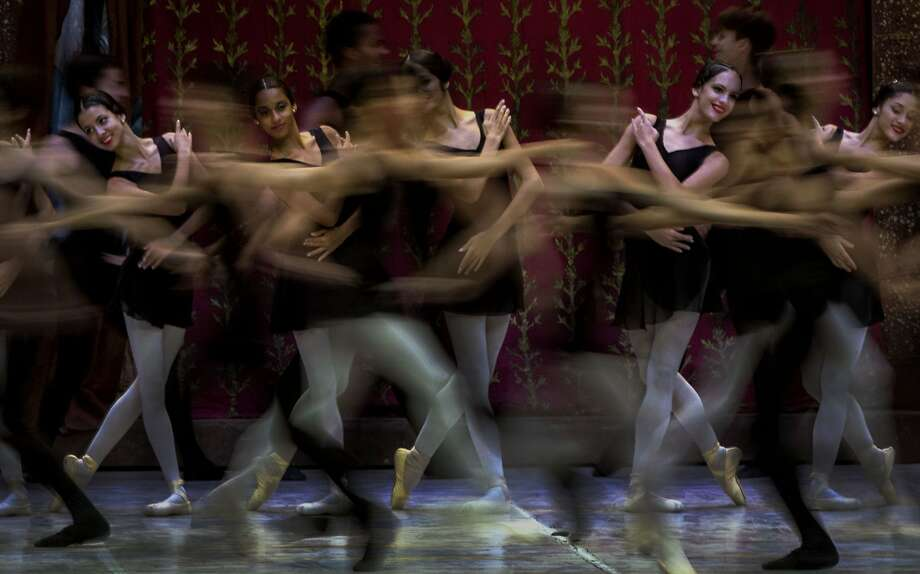 Dancers perform during the opening of the 24th International Ballet Festival at the 'Karl Marx' theater in Havana, Cuba, Tuesday, Oct. 28, 2014. The International Ballet Festival of Havana is held every two years and will take place from October 28 to November 7, with more than twenty performances and 10 world premieres planned. (AP Photo/Ramon Espinosa) Photo: Ramon Espinosa, Associated Press