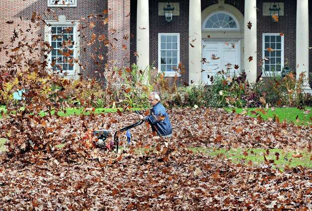 Evaristo Valentine of Parks and Recreation blows leaves on the mall in front of the Victoria Pool at Saratoga Spa State Park Tuesday Oct. 28, 2014, in Saratoga Springs, NY.  (John Carl D'Annibale / Times Union) Photo: John Carl D'Annibale