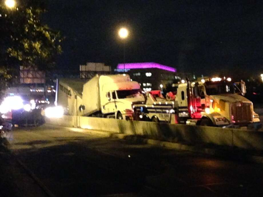 A semi-truck flipped over near Interstate 35 south and Interstate 10 west interchange causing a major traffic jam overnight on Oct. 28, 2014. Photo: By Mark D. Wilson/San Antonio Express-News