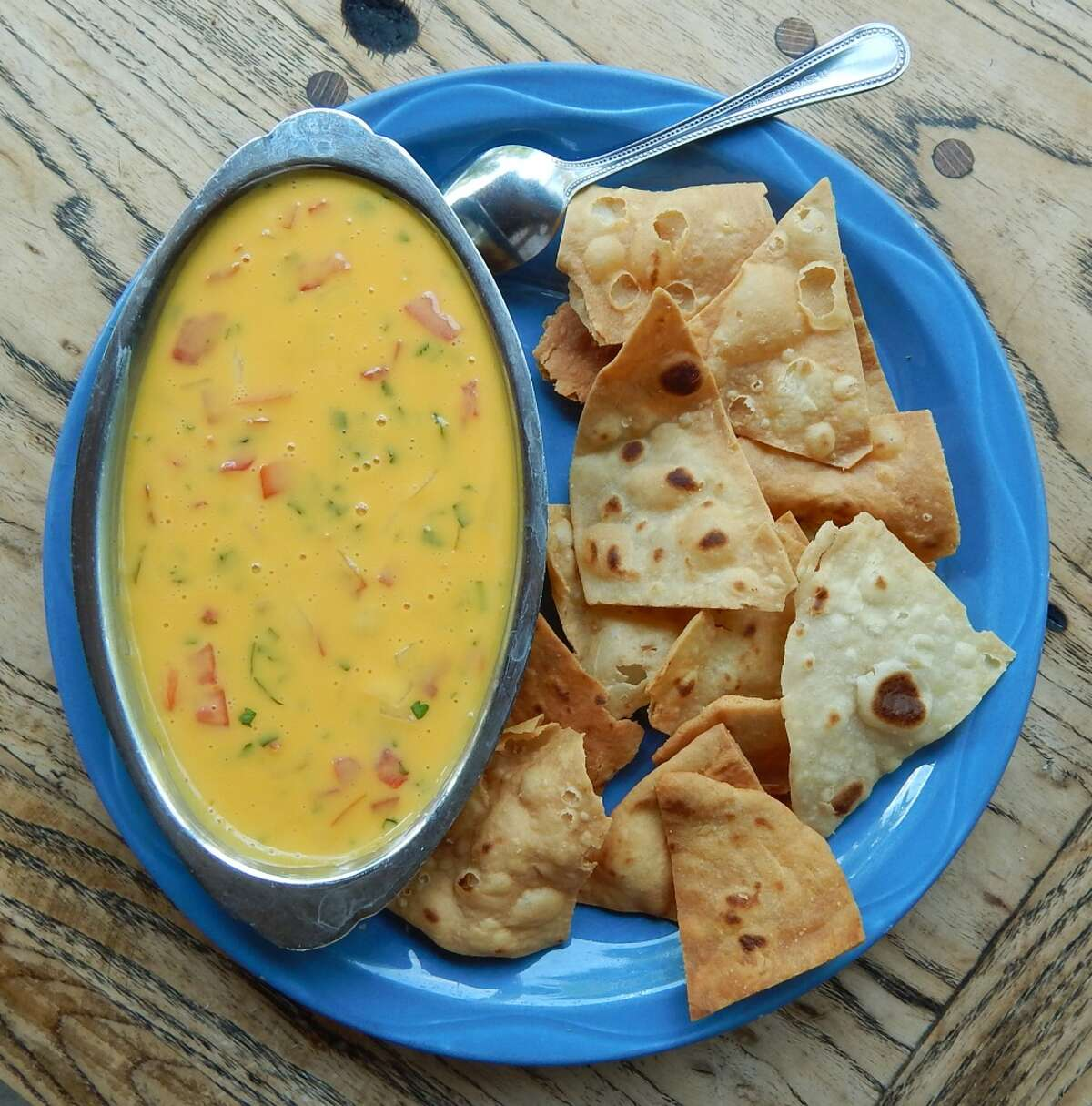 3) Chile con queso If you live anywhere in the south you know how essential this dip it. Not to worry though it really only takes some Velveeta, a can of Rotell and a slow cooker. Unless of course you want to get all fancy with your cheese dip.