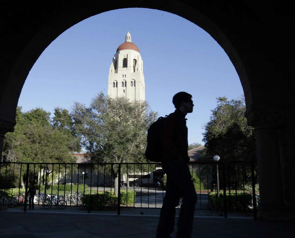 A Stanford University student walks in front of Hoover Tower on the Stanford University campus in Palo Alto, California.