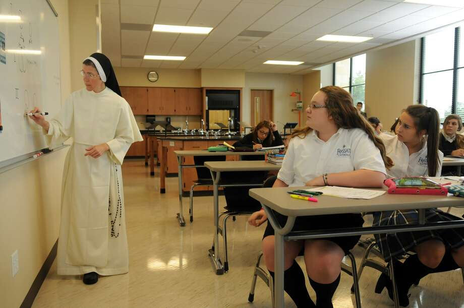 Sister Mary Albert, left, teaches a section of freshman physics at Frassati Catholic High School. Photo: Jerry Baker, Freelance