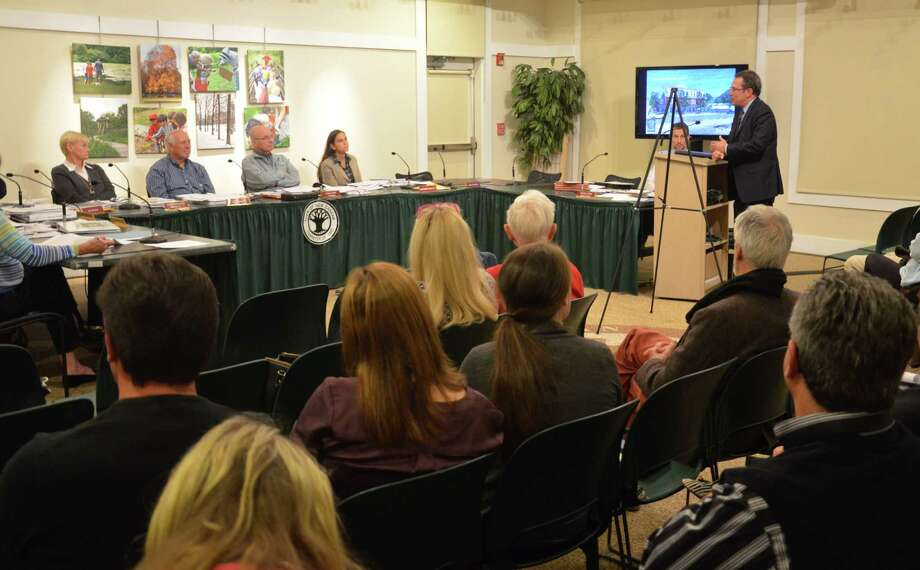 Local developer Arnold Karp, of Karp Associates, addresses the Planning and Zoning Commission during a public hearing Tuesday night, Oct. 29, 2014, on a proposed building on 16 Cross St., New Canaan, Conn. Photo: Nelson Oliveira / New Canaan News