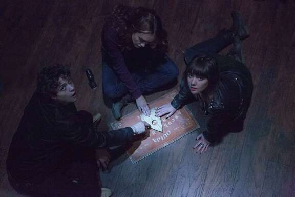 """Douglas Smith, from left, Olivia Cooke and Ana Coto star in """"Ouija."""""""