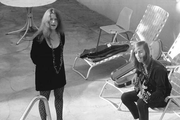 John Byrne Cooke's book, which features previously unseen photos, here shows Janis Joplin and Sam rehearse on a motel patio.