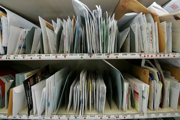 "FILE - In this Feb. 23, 3006 file photo, mail for one route in the Mid-City section of New Orleans is sorted and waits to be picked up by recipients at the New Orleans post office. An internal Postal Service audit says about 49,000 pieces of mail were monitored during the last fiscal year under a far-reaching federal surveillance program and more oversight is needed to ease privacy concerns. Under the program, called ""mail covers,"" information on the outside of a piece of mail is recorded for use in law enforcement investigations. Postal Service spokeswoman Toni DeLancey says it is used only under limited circumstances."" (AP Photo/Carolyn Kaster, File)"
