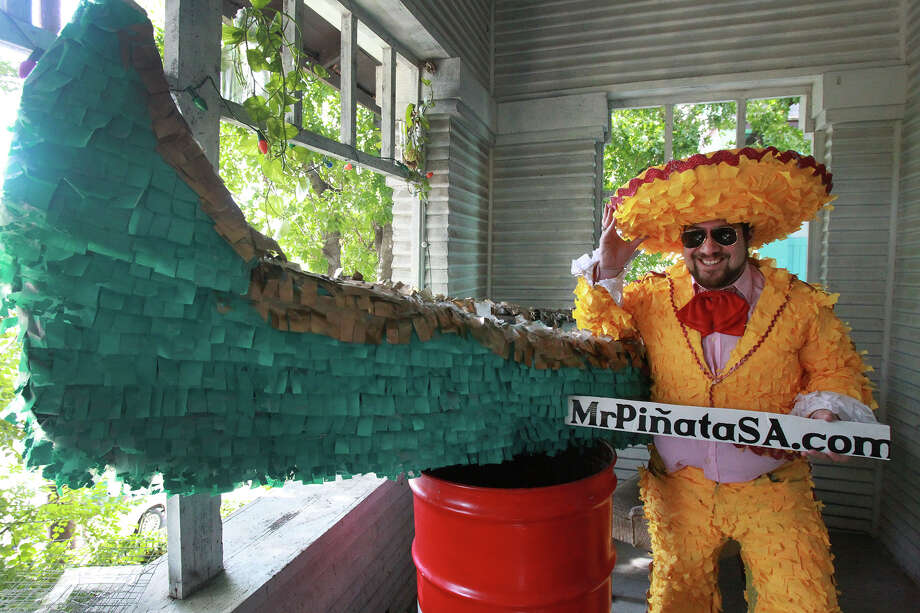 """Avi Avalos, also known as """"Mr. Pinata,"""" is a San Antonio artist who is participating in Luminaria for the first time this year. Photo: JOHN DAVENPORT, STAFF / San Antonio Express-News / ©San Antonio Express-News/John Davenport"""