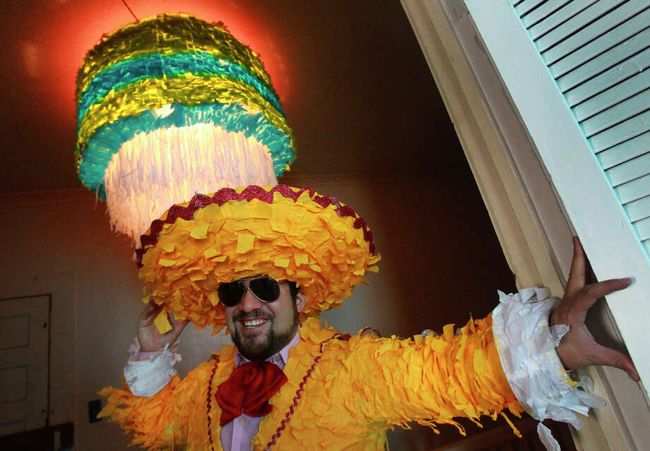 """Avi Avalos, also known as """"Mr. Pinata,"""" wears one of his illuminated creations as he prepared for Luminaria last month. Photo: JOHN DAVENPORT / John Davenport / San Antonio Express-News / ©San Antonio Express-News/John Davenport"""