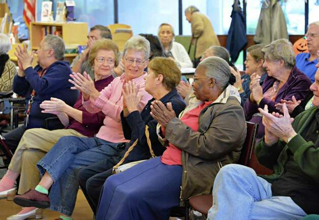 Seniors applaud during a performance by Opera Saratoga at the Westview Senior Center Wednesday, Oct. 29, 2014, in Albany, N.Y. The event coincided with National Opera Week and included a preview from OperaSaratoga's upcoming production of Rossini's Cinderella (La Cenerentola).  (John Carl D'Annibale / Times Union) Photo: John Carl D'Annibale / 00029187A