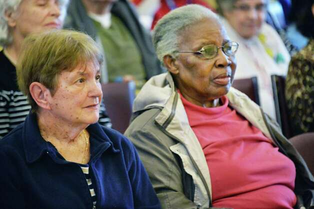 Seniors Anne Volmer, left, and Ruth Pottinger, both of Albany, listen to a performance by Opera Saratoga at the Westview Senior Center Wednesday Oct. 29, 2014, in Albany, NY.  (John Carl D'Annibale / Times Union) Photo: John Carl D'Annibale / 00029187A