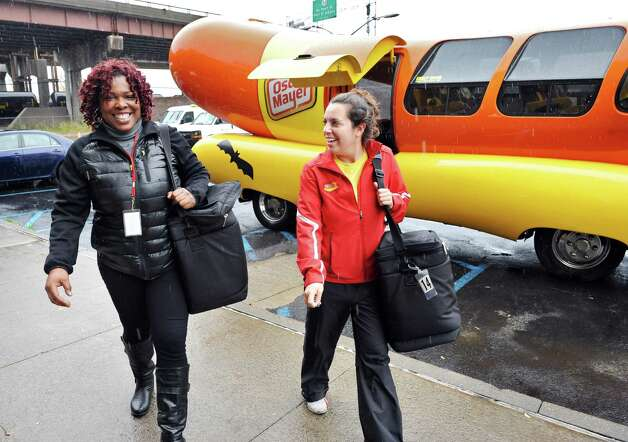 Colita Willis, packing coordinator for the Meals on Wheels program of Senior Services of Albany, and Oscar Mayer Hotdogger Alexandra Longo return  from delivering lunches in the Wienermobile Wednesday Oct. 29, 2014, in Albany, NY.  (John Carl D'Annibale / Times Union) Photo: John Carl D'Annibale / 00029254A