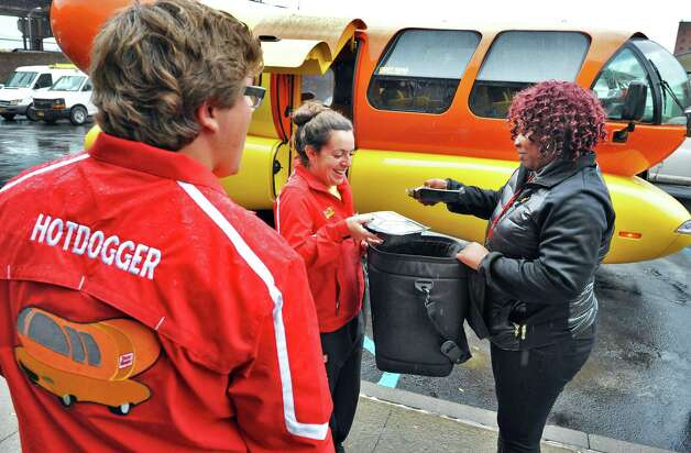 Oscar Mayer Hotdoggers Matt Heng, left, and Alexandra Longo check out meats to be delivered in the Wienermobile with Colita Willis, right, packing coordinator for the Meals on Wheels program of Senior Services of Albany Wednesday Oct. 29, 2014, in Albany, NY.  (John Carl D'Annibale / Times Union) Photo: John Carl D'Annibale / 00029254A