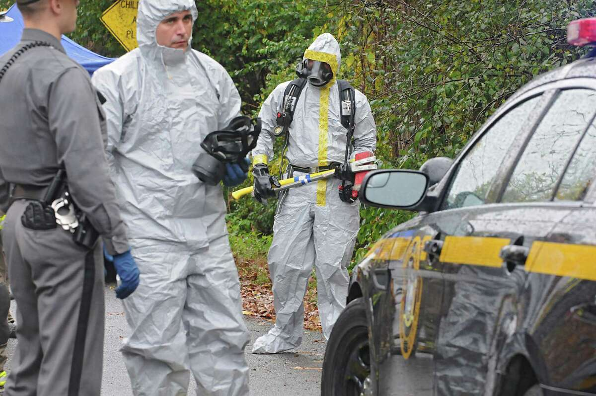 State troopers and a hazemat crew work on removing the last of about 150 cats from a cat hoarder's house on Wednesday, Oct. 29, 2014 in Schaghticoke, N.Y. (Lori Van Buren / Times Union)