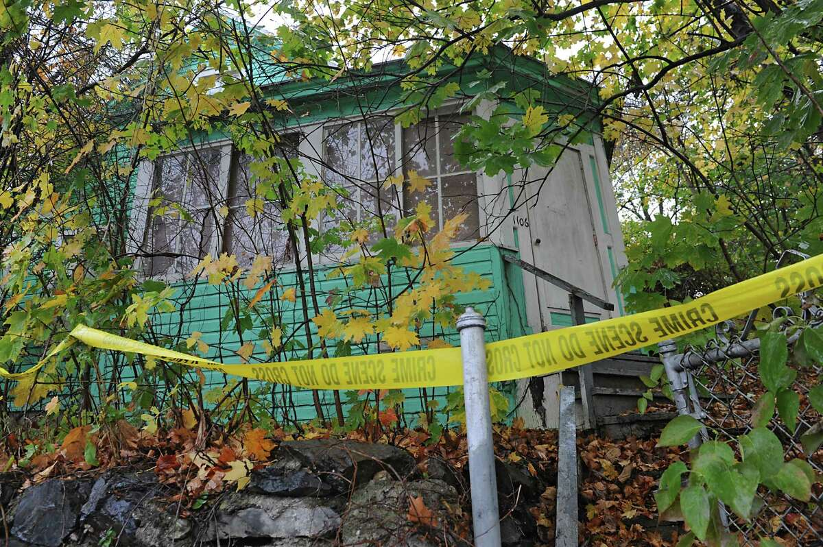 Exterior of a cat hoarder's house at 1106 River Road on Wednesday, Oct. 29, 2014 in Schaghticoke, N.Y. The police were removing the last of about 150 cats from the deplorable home. (Lori Van Buren / Times Union)