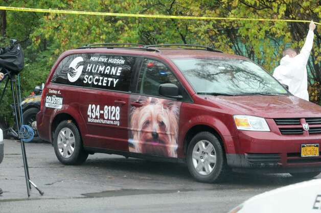 A Mohawk Hudson Humane Society van leaves the scene of a cat hoarder's house on Wednesday, Oct. 29, 2014 in Schaghticoke, N.Y. The van is presumed to be full with cats and headed back to the shelter. (Lori Van Buren / Times Union) Photo: Lori Van Buren / 00029244A