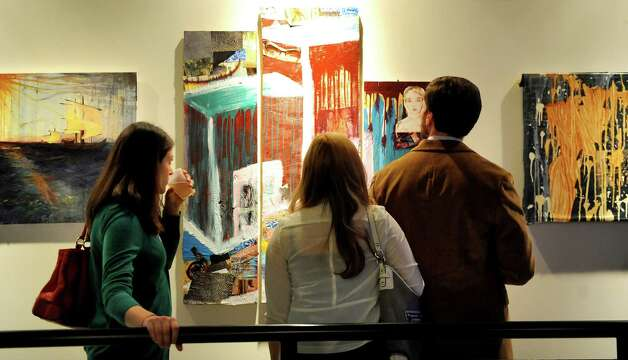 Guests take in the artwork during the Fusion fundraiser on Friday, Oct. 17, 2014, at the Albany Barn in Albany, N.Y. (Cindy Schultz / Times Union) Photo: Cindy Schultz / 00029050A