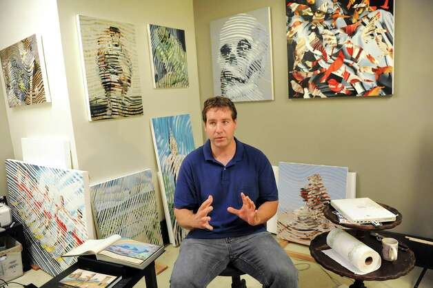 """Artist Jim Paulsen sits among his oil paint series entitled """"Double Takes"""" in his studio during the Fusion fundraiser on Friday, Oct. 17, 2014, at the Albany Barn in Albany, N.Y. (Cindy Schultz / Times Union) Photo: Cindy Schultz / 00029050A"""