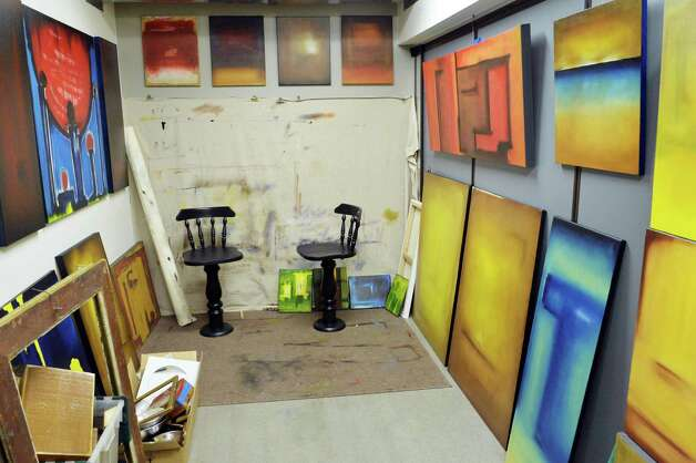 Paintings line the walls of artist Tony Iadicco's studio at the Albany Barn Wednesday Oct. 22, 2014, in Albany, NY.  (John Carl D'Annibale / Times Union) Photo: John Carl D'Annibale / 00029051A
