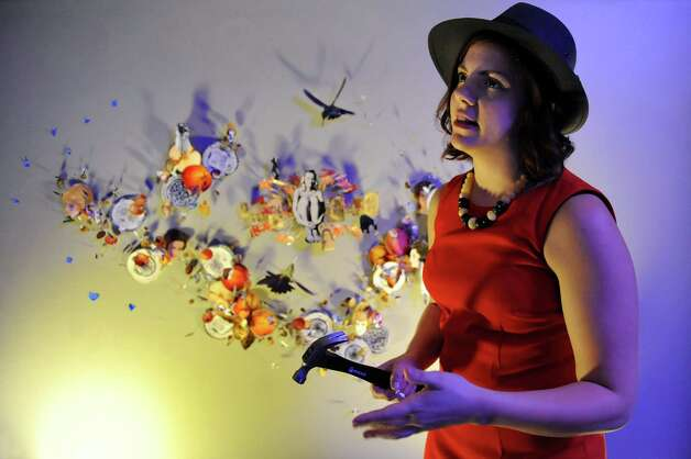"""Artist and resident Emily Dorr works on a collage installation entitled """"I do, don't I?"""" during the Fusion fundraiser on Friday, Oct. 17, 2014, at the Albany Barn in Albany, N.Y. (Cindy Schultz / Times Union) Photo: Cindy Schultz / 00029050A"""