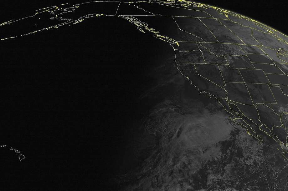 This NOAA satellite image taken Wednesday, October 29, 2014 at 11:00 AM EDT shows clouds across northern California, the Pacific Northwest, Intermountain West, and Northern Plains with scattered rain showers. Photo: Noaa, Associated Press