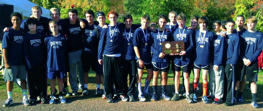 Coach Tom Scarola, second from the right, and his Spartan harrier contingent proudly pose with their state class 'S' title plaque shortly after winning their race at Wickham Park in Manchester. Oct. 25, 2014 Photo: Norm Cummings / The News-Times
